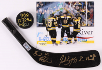 Lot of (3) Brad Marchand, Patrice Bergeron & David Pastrnak Signed Bruins Logo Items with (1) Hockey Puck, (1) Stick Blade, & (1) 8x10 Photo (The Perfection Line COA) at PristineAuction.com