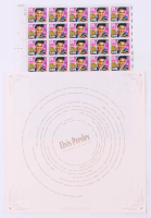 Elvis Presley Full Uncut Stamp Sheet with (40) Stamps & Record Sleeve at PristineAuction.com