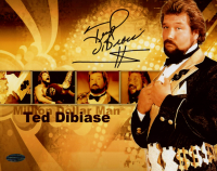 "Ted DiBiase Signed WWE 8x10 Photo Inscribed ""$"" (Playball Ink Hologram) at PristineAuction.com"