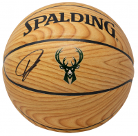 Giannis Antetokounmpo Signed Woodgrain Bucks Logo Basketball (JSA COA) at PristineAuction.com