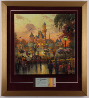 """Thomas Kinkade 50th Anniversary """"Disneyland"""" 20x22 Custom Framed Canvas on Wood Display with Full Vintage Ticket Booklet at PristineAuction.com"""