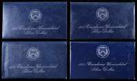 Lot of (4) Uncirculated Eisenhower Silver Dolllars in Blue Sleeves from The Department of The Treasury with (1) 1971 & (3) 1974 at PristineAuction.com