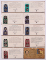 Lot of (10) Coins from the United States Mint with (9) State Quarters & (1) Sacagawea Dollar at PristineAuction.com