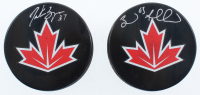 Lot of (2) Signed 2016 World Cup of Hockey Team Canada Logo Hockey Pucks with Patrice Bergeron & Brad Marchand (Bergeron COA & Marchand Hologram) at PristineAuction.com