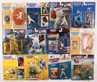 Lot of (12) Hall of Fame Vintage Starting Lineup Figurines with Sealed Cards including (2) Ken Griffey Jr., (2) Cal Ripken Jr., Cy Young, Jeff Gordon, Jesse Owens, Reggie Jackson, Jeremy Roenick at PristineAuction.com