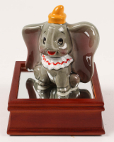 """Vintage 1970's """"Dumbo"""" Ceramic Figurine With Wood Base at PristineAuction.com"""