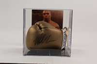 Mike Tyson Signed Everlast Boxing Glove With Photo Display Case (PSA Hologram) at PristineAuction.com