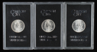 Lot of (3) Carson City Mint Morgan Silver Dollars with 1882-CC, 1883-CC & 1884-CC (GSA Holders, Brilliant Uncirculated) at PristineAuction.com