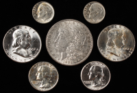 Lot of (7) 90% Silver Coins at PristineAuction.com