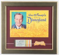 "Walt Disney's ""Disneyland"" 15.5x16.5 Custom Framed 1965 Original Souvenir Guide Display with Vintage Ticket Booklet & Employee Patch at PristineAuction.com"