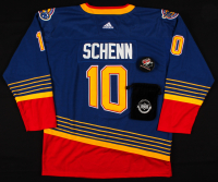 Lot of (2) Brayden Schenn Hockey Items with (1) Signed Team Canada Hockey Puck & (1) Unsigned Blues Throwback Jersey (UDA COA) at PristineAuction.com