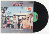 "1976 AC/DC ""Dirty Deeds Done Dirt Cheap"" Vinyl Record Album Band-Signed by (4) Angus Young, Brian Johnson, Cliff Williams, & Malcolm Young (PSA Hologram) at PristineAuction.com"