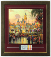 "Thomas Kinkade 50th Anniversary ""Disneyland"" 20.5x22.5 Custom Framed Canvas on Wood Display with Full Vintage Ticket Booklet at PristineAuction.com"