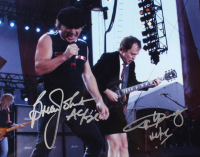 "Angus Young & Brian Johnson Signed AC/DC 8x10 Photo Inscribed ""AC/DC"" (PSA LOA) at PristineAuction.com"