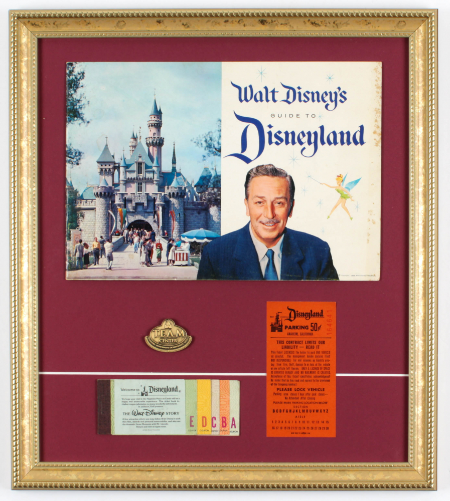 "Walt Disney's ""Disneyland"" 16.5x17.5 Custom Framed 1959 Original Souvenir Guide Display with Vintage Ticket Booklet, .50 Parking Pass & Brass Employee Pin at PristineAuction.com"