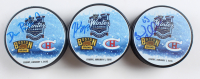 Lot of (3) Signed Bruins 2016 Winter Classic Hockey Pucks with Brad Marchand, Patrice Bergeron & David Pastrnak (Bergeron, Marchand & Pastrnak COA) at PristineAuction.com