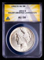 Mint Error - 1922 Peace Silver Dollar, Obverse Lamination (ANACS AU58) at PristineAuction.com
