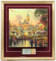 "Thomas Kinkade 50th Anniversary ""Disneyland"" 20x22 Custom Framed Canvas on Wood Display with Vintage Ticket Booklet at PristineAuction.com"