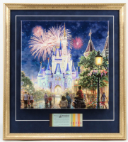 "Thomas Kinkade ""Disneyland"" 20x22 Custom Framed Canvas on Wood Display with Vintage Ticket Booklet at PristineAuction.com"