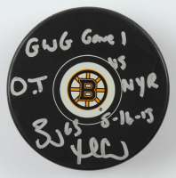 """Brad Marchand Signed Bruins Logo Hockey Puck Inscribed """"GWG Game 1 O.T. NYR 5-16-13"""" (YSMS COA) at PristineAuction.com"""