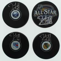 Lot of (4) John Scott Signed Hockey Pucks with Blackhawks, Rangers, 2016 All-Star, & Sabres (Scott COA) at PristineAuction.com