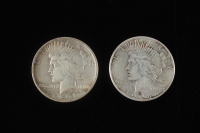 Lot of (2) Peace Silver Dollars with 1921 & 1928 at PristineAuction.com