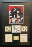"""KISS"" 18x26 Custom Framed Cut Display Signed by (4) with Gene Simmons, Paul Stanley, Ace Frehley & Peter Criss (JSA COA) at PristineAuction.com"