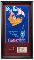 "Disneyland ""Peter Pan"" 15x26 Custom Framed Poster Display with (2) Vintage 1960 Peter Pan Figurines & Ticket at PristineAuction.com"