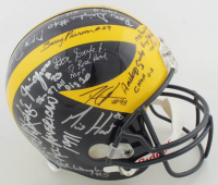 Michigan Wolverines Logo Full-Size Helmet Signed By (23) with Anthony Carter, Desmond Howard, Larry Foote, Tom Mack with Multiple Inscriptions (JSA ALOA) at PristineAuction.com