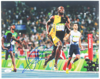 Usain Bolt Signed Team Jamaica 11x14 Photo (JSA COA) at PristineAuction.com