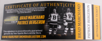 """Brad Marchand & Patrice Bergeron Signed Bruins """"Hockey Fights Cancer"""" Logo Snapback Hat Inscribed """"Cancer Sucks"""" & """"F*** Cancer"""" (Marchand COA & Bergeron COA) at PristineAuction.com"""