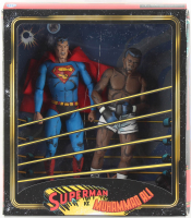 Superman Vs. Muhammad Ali Action Figures with Box at PristineAuction.com