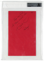 """Eric Clapton Signed 6x9 Cut Inscribed """"For My Girl, A True Friend & Fan"""" & """"07"""" (BGS Encapsulated) at PristineAuction.com"""