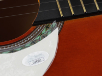 "Ted Nugent Signed Full-Size Acoustic Guitar Inscribed ""01"" (JSA COA) at PristineAuction.com"
