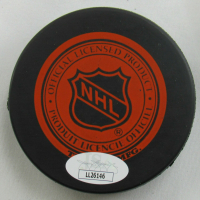 Gordie Howe Signed Red Wings Logo Hockey Puck (JSA COA) at PristineAuction.com