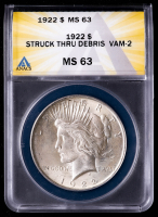 Mint Error - 1922 Peace Silver Dollar, Struck Thru Debris, Vam-2 (ANACS MS63) at PristineAuction.com