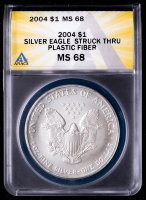 Mint Error - 2004 American Silver Eagle $1 One Dollar Coin, Struck Thru Plastic Fiber (ANACS MS68) at PristineAuction.com