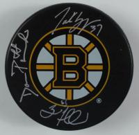 Brad Marchand, Patrice Bergeron & David Pastrnak Signed Bruins Logo Hockey Puck (Marchand, Bergeron & Pastrnak COA) at PristineAuction.com