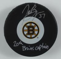 "Patrice Bergeron Signed Bruins Logo Hockey Puck Inscribed ""20th Bruins Captain"" (Bergeron COA) at PristineAuction.com"