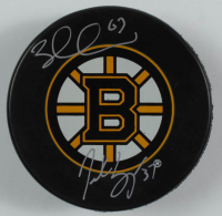 Patrice Bergeron & Brad Marchand Signed Bruins Logo Hockey Puck (Bergeron & Marchand COA) at PristineAuction.com