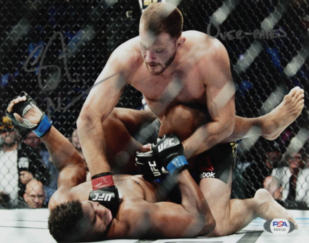 """Stipe Miocic Signed 8x10 Photo Inscribed """"OVER-RATED"""" (PSA Hologram) at PristineAuction.com"""