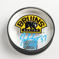 Patrice Bergeron Signed Bruins Logo Acrylic Hockey Puck (Bergeron COA) at PristineAuction.com