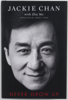 "Jackie Chan Signed LE ""Never Grow Up"" Hardcover Book Inscribed ""Best Wishes"" & ""Enjoy"" (Premiere Collectibles COA) at PristineAuction.com"