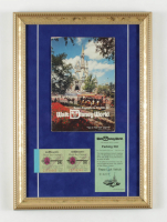 Vintage Walt Disney World 12x17 Custom Framed Souvenir Guide Display with Ticket Book & .50 Cent Parking Pass at PristineAuction.com