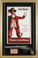 "Disney World ""Pirates of the Caribbean"" 17x26 Custom Framed Print with Pirates of the Caribbean Souvenir Gun & Ticket at PristineAuction.com"