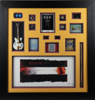 "Alex Lifeson, Neil Peart, & Geddy Lee Signed ""Rush"" 36x38 Custom Framed Display (PSA LOA) (See Description) at PristineAuction.com"
