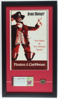 "Vintage Disneyland ""Pirates of the Caribbean 15x26 Custom Framed Print with Disneyland Ticket Book & Pirates of the Caribbean Brass Emblem at PristineAuction.com"