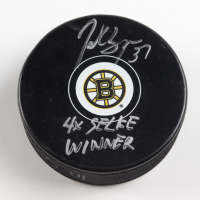 Patrice Bergeron Signed Bruins Logo Hockey Puck with Inscription (Bergeron COA & YSMS Hologram) at PristineAuction.com