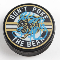 Patrice Bergeron & Brad Marchand Signed Bruins Throwback Logo Hockey Puck (Bergeron, Marchand COA & YSMS Hologram ) at PristineAuction.com