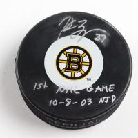 "Patrice Bergeron Signed Bruins Logo Hockey Puck Inscribed ""1st NHL Game 10 - 8 - 03 NJD"" (Bergeron COA & YSMS Hologram) (See Description) at PristineAuction.com"